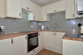 Fully equipped kitchen with electric fan oven, induction hob and microwave